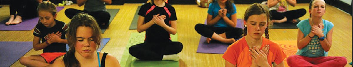 Missfit yoga class with girls in meditation