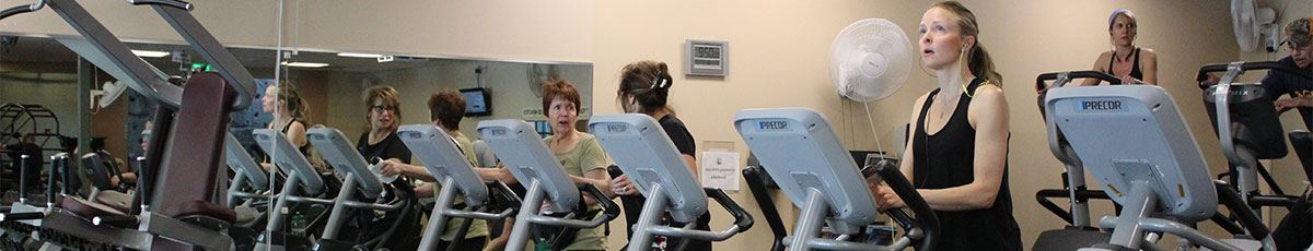Workplace Wellness with women on treadmills
