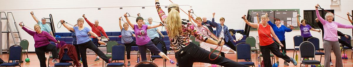 Older adults in class exercising with elastic bands