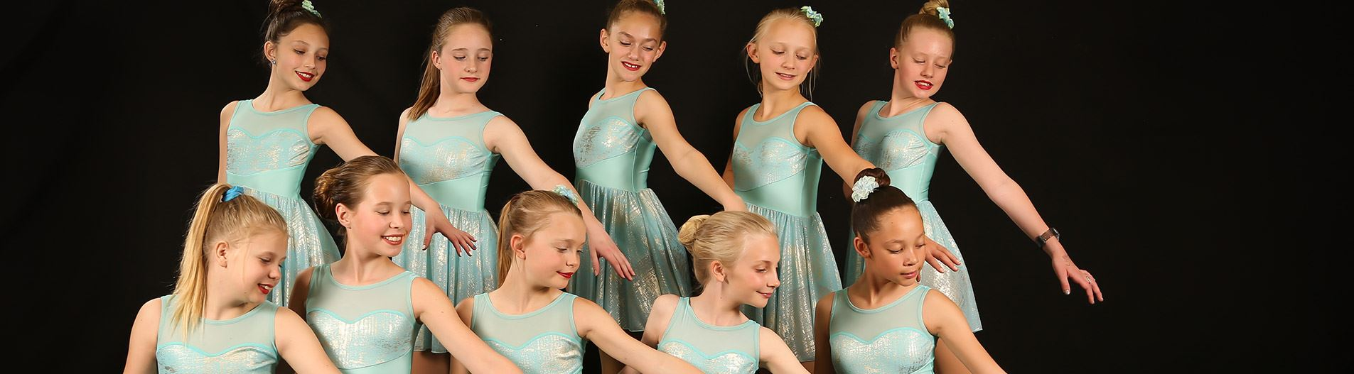 Youth dressed in dance outfits for group portrait