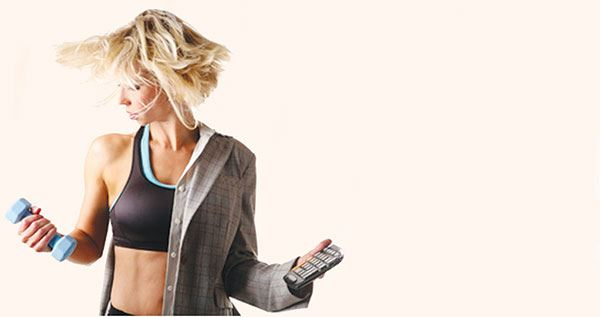 Workplace wellness program, woman with cellphone and dumbbell